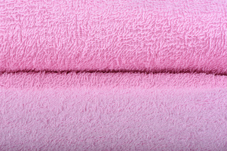 Pink terry towel. The texture of the cloth towels. Close up Stock Photo