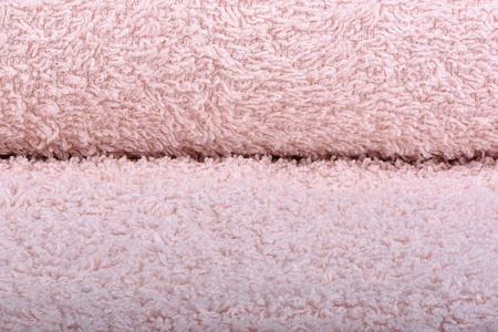 Light pink terry towel. The texture of the cloth towels. Close up