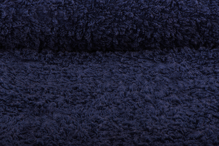 Dark blue terry towel. The texture of the cloth towels. Close up Stock Photo