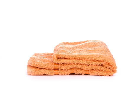 Orange terry towel isolated on a white background. Stock Photo