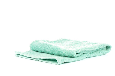 Light green terry towel isolated on white background.