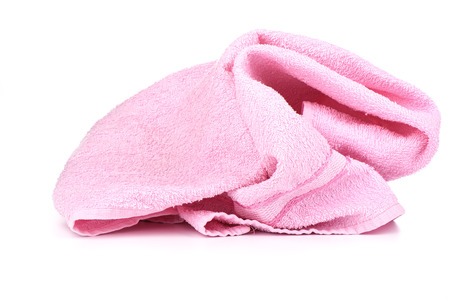 Pink terry towel isolated on white background.