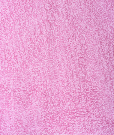 The texture of the fabric is pink terry towel. Terry cloth as a background.