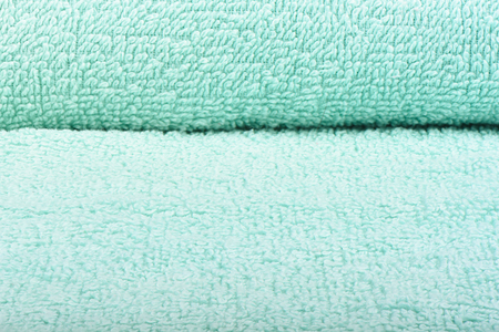 Light green terry towel. The texture of the cloth towels. Stock Photo
