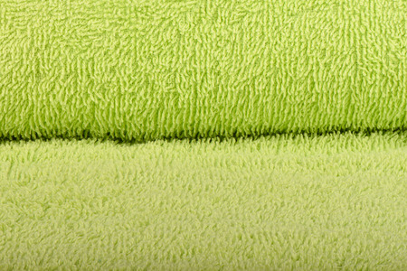 Green terry towel. The texture of the cloth towels.