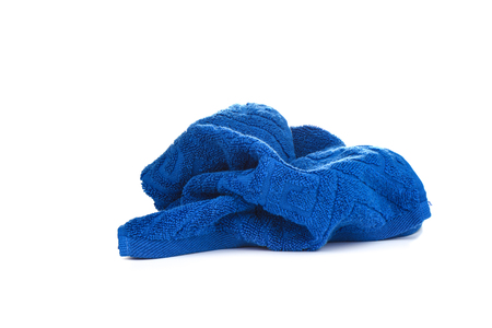Blue terry towel isolated on white background. Stock Photo