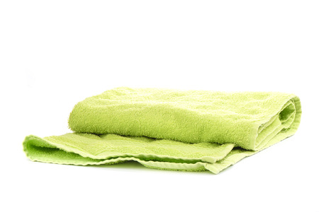 Green terry towel isolated on white background.