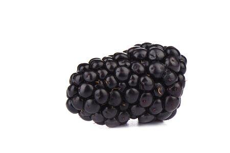 Ripe blackberry over white background. Macro shot. Copy space Stock Photo