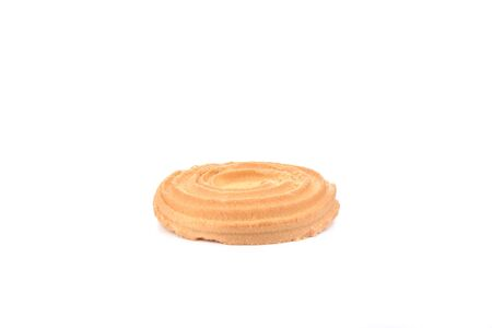 Round butter biscuits isolated on a white background. Sweet butter cookies. Close up. Copy space