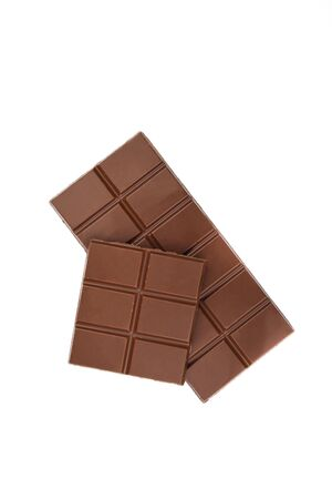 Whole chocolate bar and half isolated on white background. Imagens