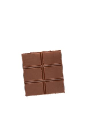 Portion of chocolate bar isolated on white background.