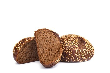 Malted bread with sesame isolated on white background. Sliced bread. Copy space.