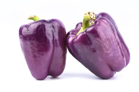 Two fresh purple bell peppers isolated on white background. Close up. Copy space Foto de archivo