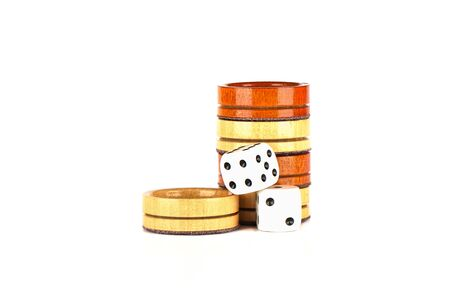 Dice and wooden backgammon checkers isolated on a white background. Copy space.