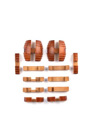 Twelve details on a barrel puzzle against a white background. Barrel puzzle is one of the Japanese Kumiki toys. Puzzle concept. Copy space