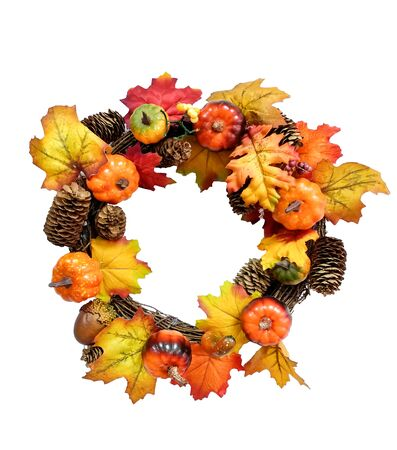 Autumn wreath with artificial pumpkins, acorns, fir cones and berries over white background. Happy Thanksgiving and Halloween design. Copy space.