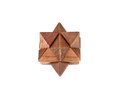 Wooden puzzle star-shaped dodecahedron isolated on white background. Twelve-sided small star dodecahedron. Copy space. Puzzle concept. Stock fotó