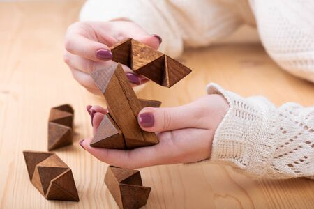 Puzzle details star-shaped dodecahedron in the hands of a girl. Stock fotó