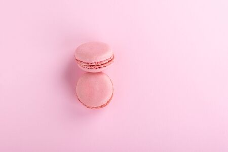 Top view. Two pink macaroons isolated on a pink background. 写真素材