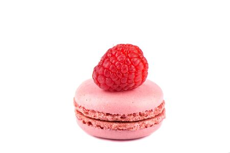 Pink macaroon with raspberry isolated on a white background. 写真素材
