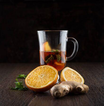 Vitamin tea with orange, lemon, mint and ginger root.