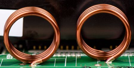 Electronic components. Inductors are soldered to the electronic board. Close up.