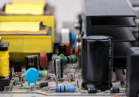Close-up of resistors, capacitors and other electronic components. The world of electronics.