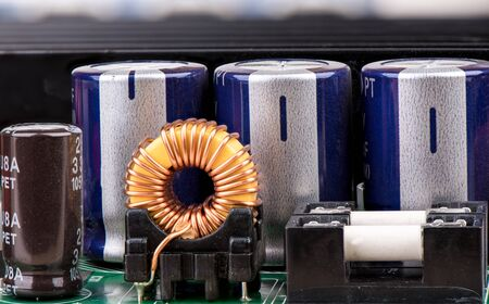 Inductor, capacitors and fuses close up. The world of electronics.