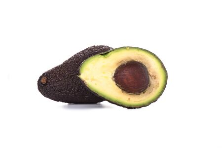 Two Haas Avocado Fruits Isolated Over White Background. Slice avocado fruit.