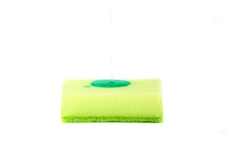 Apply antiseptic chemicals to a kitchen sponge. Kitchen sponge isolated on a white background. Healthy lifestyle.