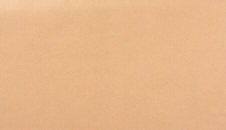 Beige leather texture background. Beige faux leather background.