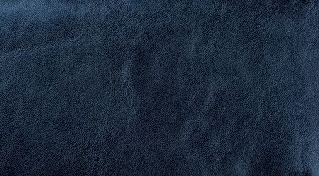 Dark blue leather texture background. Dark blue artificial leather background.