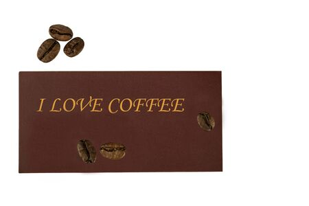 A few beans of coffee and a label that says I love coffee. Copy space. Flat lay. Banco de Imagens