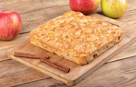 Homemade cinnamon apple pie on a cutting board. Stock Photo