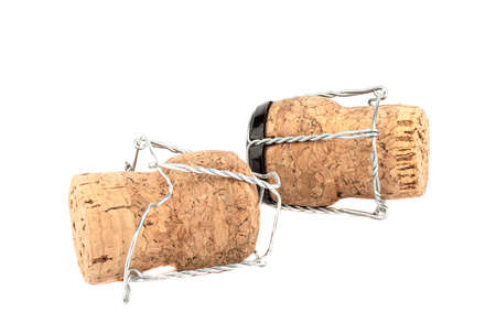 Two champagne corks with muselet isolated on white background.