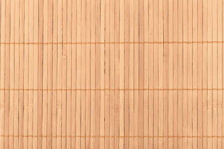 Full frame close-up shot of a bamboo food mat. Traditional kitchen utensils.
