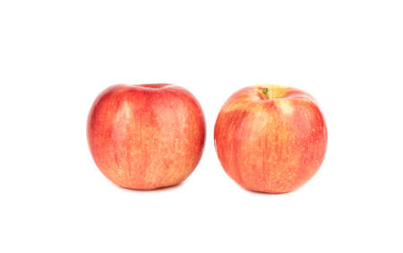Two red ripe apples isolated on a white background.