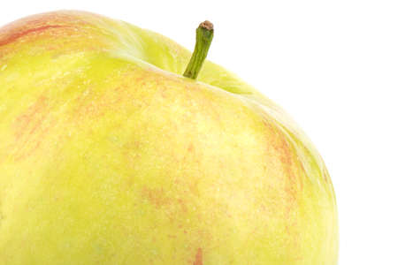 Macro shot of the top of a ripe apple on a white background.