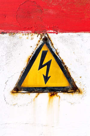 High voltage sign on rusty background Stock Photo - 8236236