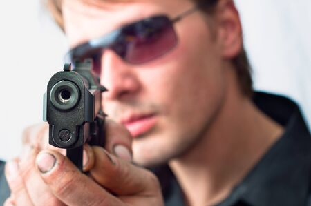 Man with gun focus on pistol with dirty hands Stock Photo - 9529990