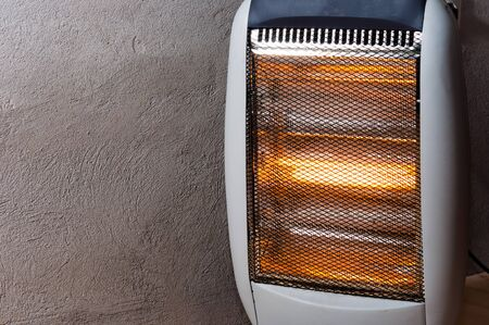 halogen: A halogen or electric heater against concrete wall