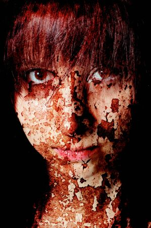 Dark art portrait of a girl with cracks and old paint photo