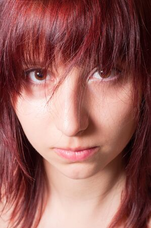 Depressed girl looking into your eyes Stock Photo - 9486304