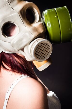 Girl wearing gasmask and white lingerie photo