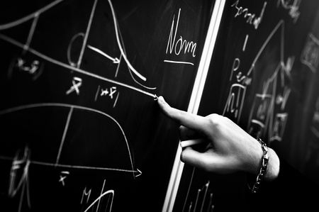 Pointing on chalk board in black and white Stock Photo - 9485572