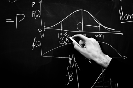 university professor: Writing on a chalk board in black and white
