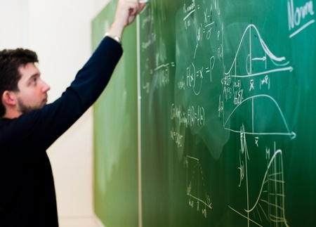physics: Writing on chalk board Stock Photo