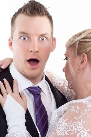Surprised groom with her wife photo