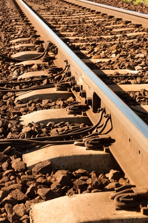 Close up shot of a rusty rails with wires attached to them Stock Photo - 9486306