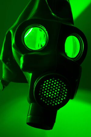 A military gasmask in green light photo